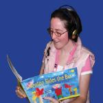 Participant reading Newton Rides a Bus book