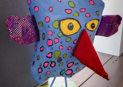 Paper maché sculpture of polka dot bird