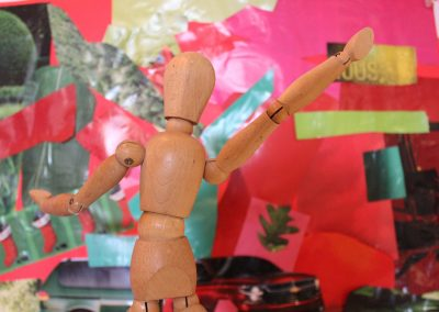 Jointed wooden sculpture, outstretched arms