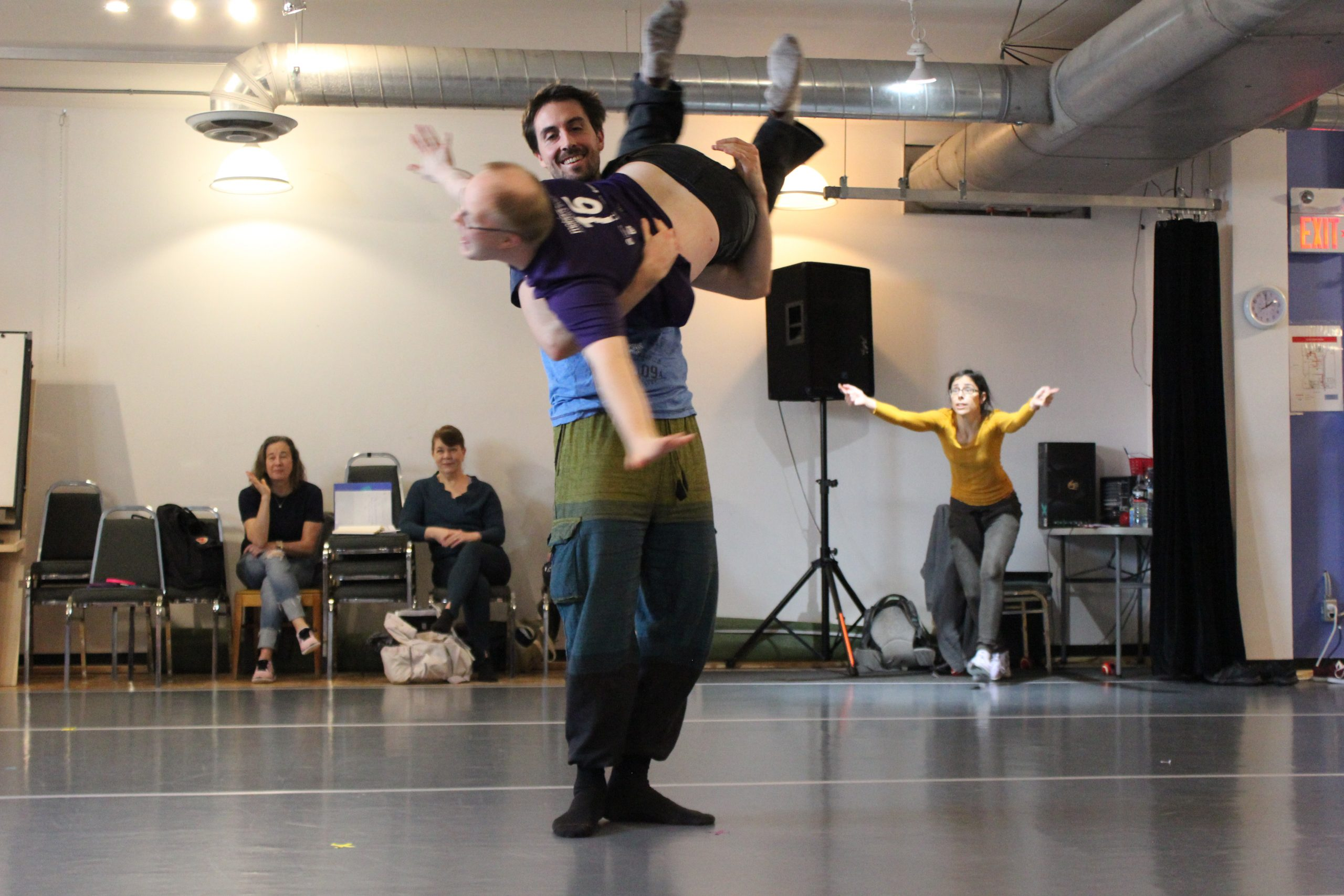 Two dancers perform a lift
