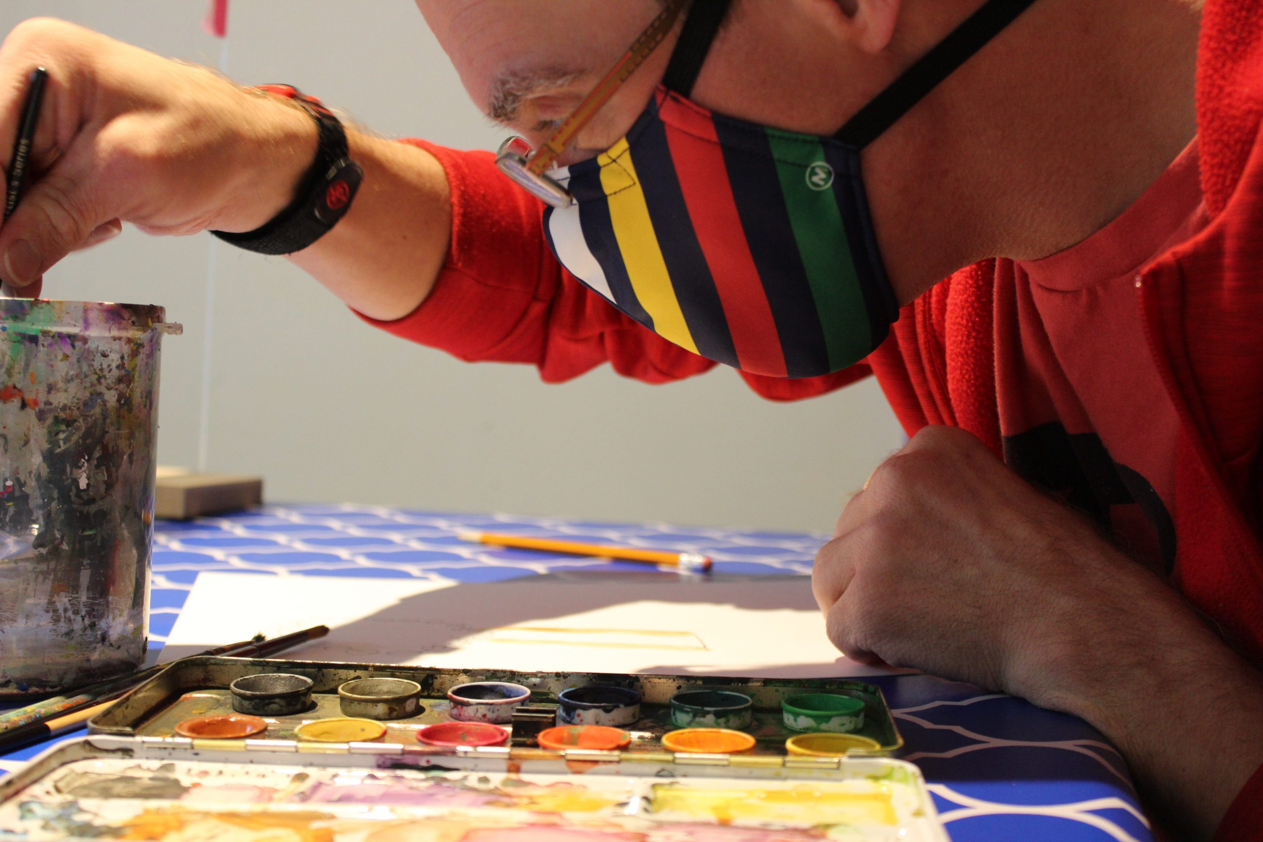 Masked H'art artists works on watercolour