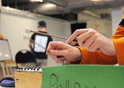 Hands holding drumsticks